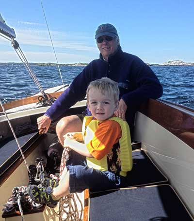 Gary Jobson sailing with his grandson, Declan.